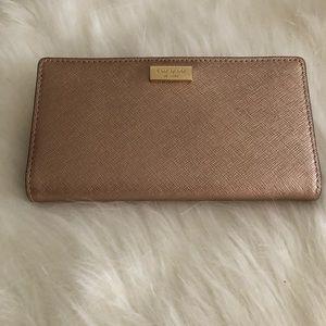 Kate Spade rose gold wallet